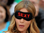 See why the Modern Family star is wearing a 'Sexy' blindfold on US TV.