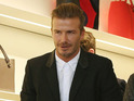 See David Beckham and fans at Victoria Beckham's flagship store opening.