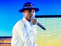 Pharrell Williams performs on stage at 02 Arena on October 9, 2014