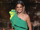 "Cheryl's dress causes a Twitter frenzy, after Simon describes her as ""Kermit""."