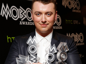 Sam Smith poses with his awards for Best R&B and Soul, Best Song, Best Album and Best Male Act in the winners room at the at the MOBO Awards at SSE Arena