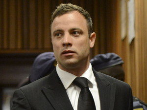 Oscar Pistorius arrives in the Pretoria High Court for sentencing in his murder trial on October 21, 2014