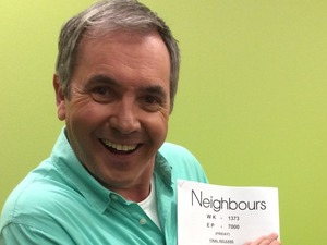 Neighbours' Alan Fletcher with the script for episode 7,000