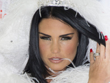 LONDON, ENGLAND - OCTOBER 22: Katie Price attends a photocall to launch her new novel 'Make My Wish Come True' at The Worx on October 22, 2014 in London, England. (Photo by Mark Cuthbert/UK Press via Getty Images)