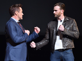 Robert Downey Jr. and Chris Evans onstage during Marvel Studios fan event at The El Capitan Theatre