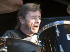 AC/DC drummer Phil Rudd arrives late in court