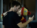 The pair are seen kissing during a football match at Los Angeles Memorial Coliseum.