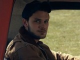Jeremy Irvine as Travis in The World Made Straight