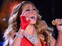 Mariah Carey struggles through Christmas hit
