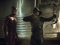Grant Gustin as The Flash and Stephen Amell as The Arrow in Arrow S03E08: 'The Brave and the Bold'