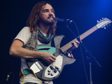 Kevin Parker of the band Tame Impala performs on stage at Latitude Festival 2014 at Henham Park Estate