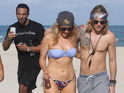 The unlikely trio hit the beach in Miami to celebrate Goulding's birthday.