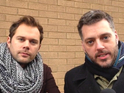 Iain Lee and Justin Dealey hold hands in a street in Luton.