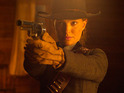 The first images from the long-delayed Western are released.