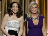 Tina Fey and Amy Poehler speak onstage during the 72nd Annual Golden Globe Awards