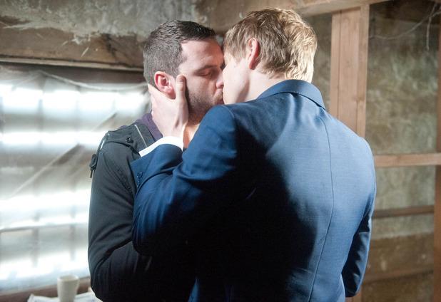 Robert kisses Aaron