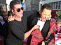Simon Cowell lifts up Walliams' kilt