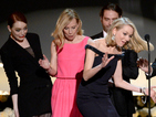Naomi Watts trips on Emma Stone's dress during SAG Awards