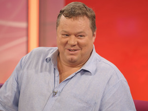 Ted Robbins - who plays Den Perry - is in stable condition after collapsing.