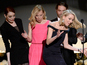 Naomi Watts trips on Emma Stone's dress