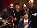 Liam Payne and Louis Tomlinson are pictured in the studio with Chad Kroeger.