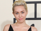 Miley Cyrus arriving at the 57th Annual Grammy Awards