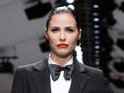 Celebrity Big Brother winner models androgynous look at Fashion for Relief event.
