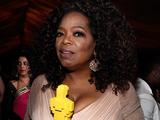 Oprah Winfrey with her Lego Oscar statuette