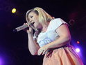 Kelly Clarkson performs during Mardi Gras celebration at Universal Orlando on February 21, 2015 in Orlando, Florida.