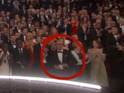 Oscar nominee seen putting folded paper back into his jacket after Eddie Redmayne wins.