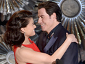 John Travolta strokes Idina Menzel's face in one of Oscars night's more bizarre moments.