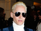The actor debuts platinum hair at Paris Fashion Week for his role as the Joker.
