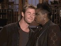 Chris Hemsworth can't get a word in around SNL's Leslie Jones and Zac Brown Band.