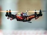 A drone flies through the air