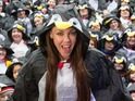 The singer leads group of poncho-clad penguin lovers to break world record.
