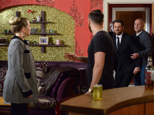 Mick bursts through the door and tries to get to Dean.