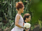 Rihanna makes an elegant bridesmaid at her assistant's wedding in Hawaii