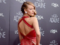 Blake Lively stuns in scarlet at premiere