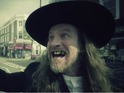 Paul Kaye is an eccentric preacher in the band's new music video.