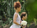 Singer Rihanna looked breathtaking in her lavender bridesmaid gown in Honolulu, HI on April 20, 2015. She was seen walking down the aisle for her assistant Jennifer Morales' wedding in a lavender tulle sleeveless dress with an intricate silver flower design and a small train behind it. Rihanna has been in the tropical island to celebrate with her friends and was seen sipping on champagne seaside the day before the big wedding