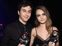 The actress collected the prize along with Paper Towns co-star Nat Wolff.