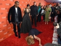 Comedian faux-tripped at the power couple's feet during the TIME 100 gala.