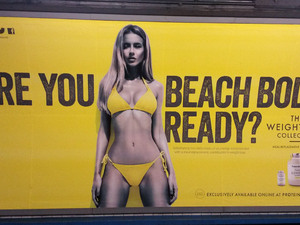 A Protein World advert displayed in an underground station in London