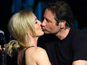 The X-Files stars duet... and kiss