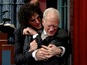 See Letterman try to avoid Howard Stern kiss