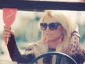 Britney leads a troupe of dancers and frolics with Iggy in a bright yellow Jeep.