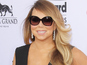 Mariah gets Bieber on remix of latest single