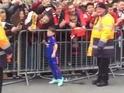 Like father, like son… Kai Rooney takes time out for the fans at Old Trafford.