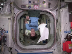 Happy Towel Day: Astronaut reads Hitchhiker's Guide to the Galaxy in space