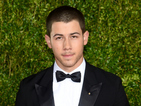 Nick Jonas previews the new music video for 'Levels' ahead of his performance at the VMAs pre-show